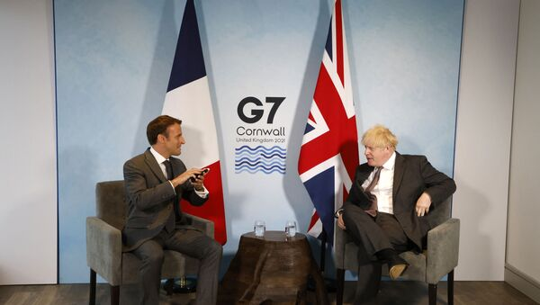 Britain's Prime Minister Boris Johnson and France's President Emmanuel Macron take part in a bilateral meeting during the G7 summit in Carbis bay, Cornwall on June 12, 2021.  - Sputnik International