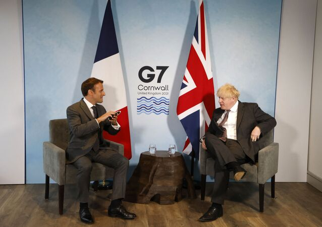 Britain's Prime Minister Boris Johnson and France's President Emmanuel Macron take part in a bilateral meeting during the G7 summit in Carbis bay, Cornwall on June 12, 2021.