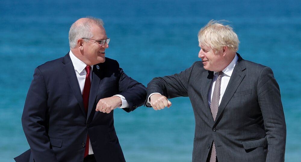 Britain's Prime Minister Boris Johnson greets Australia's Prime Minister Scott Morrison during an official welcome at the G7 summit in Carbis Bay, Cornwall, Britain, 12 June 2021.