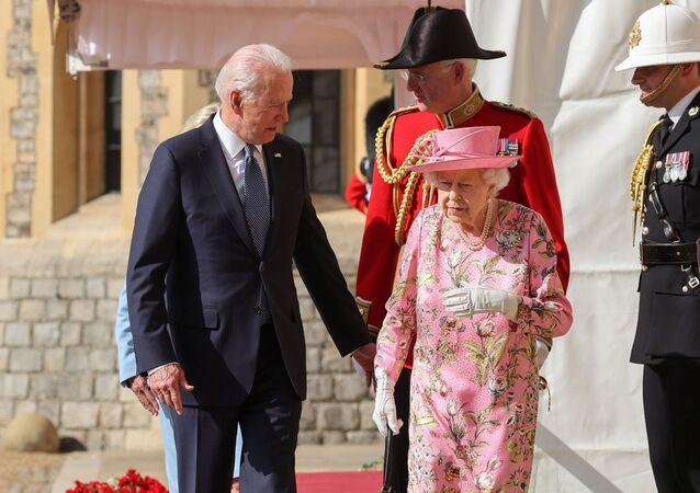 Britain's Queen Elizabeth walks with U.S. President Joe Biden and first lady Jill Biden as they meet at Windsor Castle, in Windsor, Britain, June 13, 2021.
