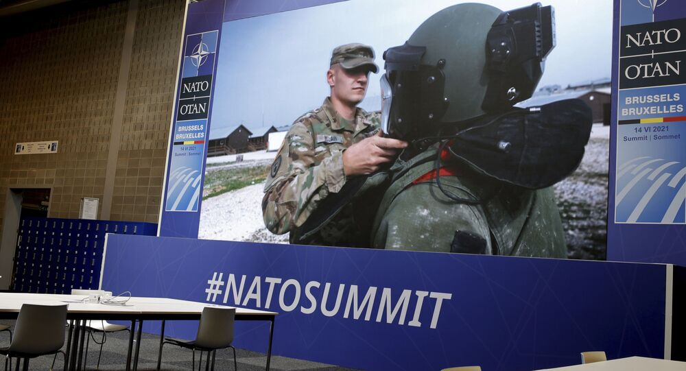NATO troops are shown on a large screen in an empty press room at NATO headquarters prior to a NATO summit in Brussels, Sunday, June 13, 2021.