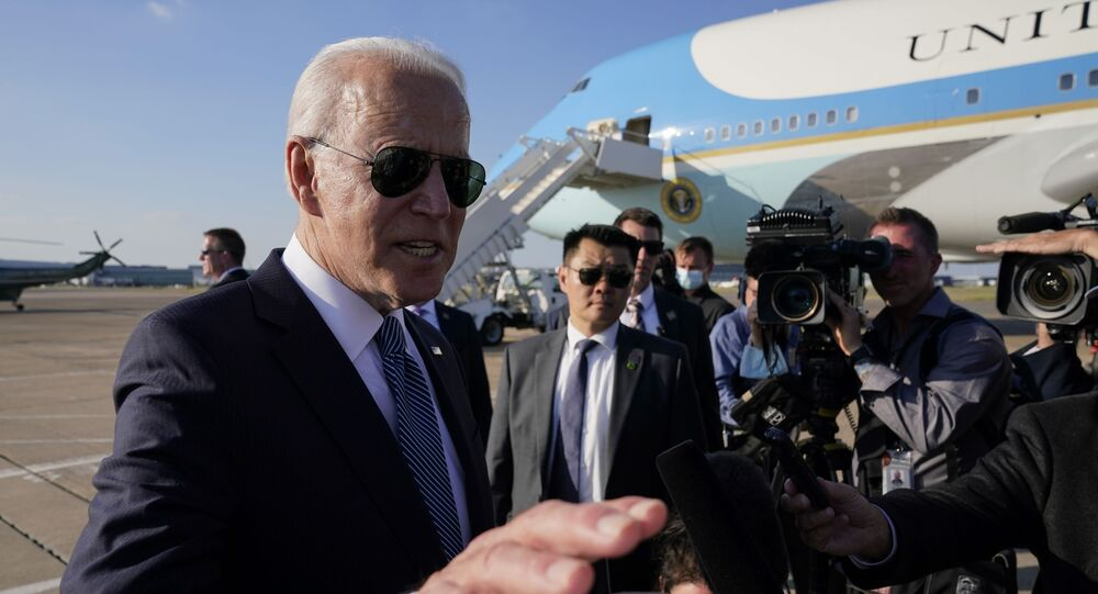 President Joe Biden speaks with reporters before boarding Air Force One at Heathrow Airport in London, Sunday, June 13, 2021. Biden is en route to Brussels to attend the NATO summit.