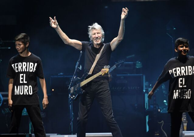 Roger Waters is joined onstage by children as he performs his song Another Brick in the Wall during his closing performance on day 3 of the 2016 Desert Trip music festival at Empire Polo Field on Sunday, Oct. 9, 2016, in Indio, Calif.