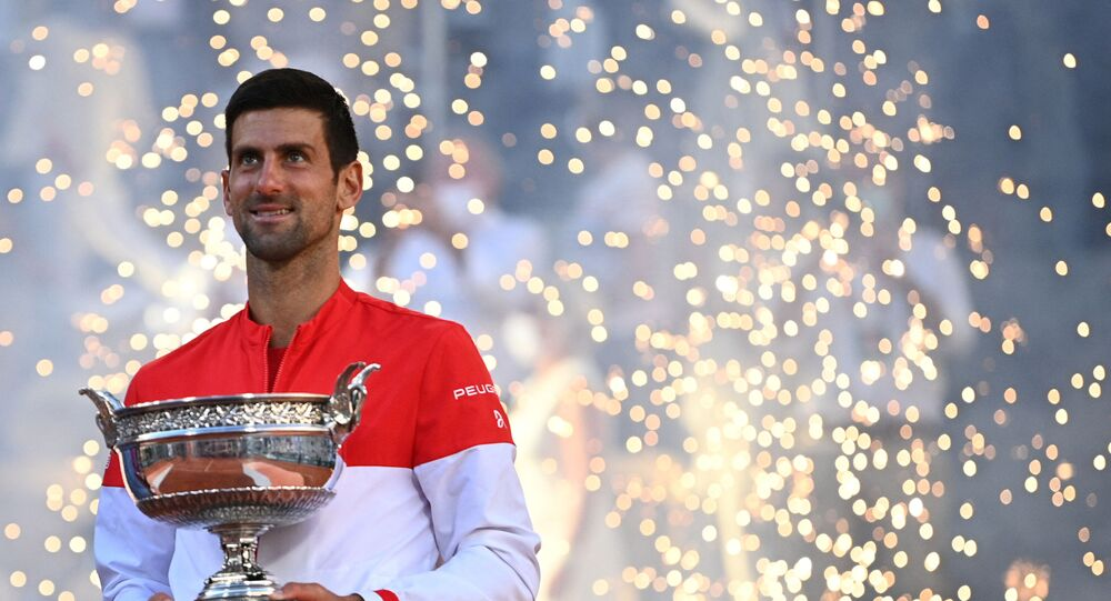 Serbia's Novak Djokovic poses with The Mousquetaires Cup (The Musketeers) after winning against Greece's Stefanos Tsitsipas at the end of their men's final tennis match on Day 15 of The Roland Garros 2021 French Open tennis tournament in Paris on June 13, 2021.