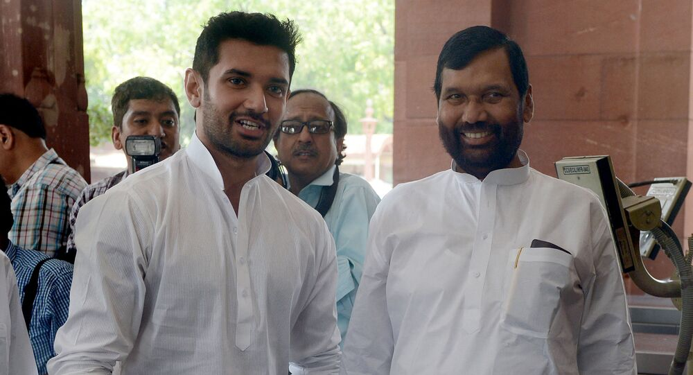 Newly elected Indian Minister of Consumer Affairs, Food and Public Distribution, Ramvilas Paswan (R) and his son, newly elected Member of Parliament (MP) Chirag Paswan arrive for the first session of India's newly elected parliament in New Delhi on June 4, 2014.