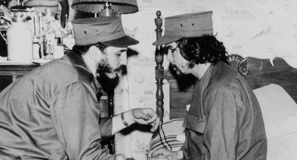 (FILES)This 1959 file photo shows Cuban Fidel Castro (L), then 33 years old, chatting with ailing 31-year-old Ernesto Che Guevara, at his barracks in Havana, shortly after both led the revolution that overthrew the Batista regime.