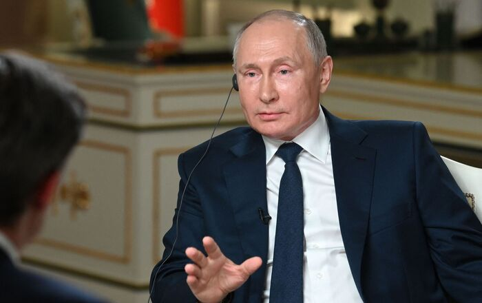 Russia's President Vladimir Putin (R) speaks with journalist of NBC News Keir Simmons in Moscow on June 11, 2021, during an exclusive interview ahead of a meeting with US President.
