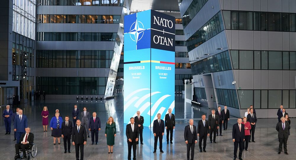 US President Joe Biden and other NATO heads of the states and governments pose for a family photo during the NATO summit at the Alliance's headquarters, in Brussels, Belgium, 14 June 2021. REUTERS/Kevin Lamarque/Pool