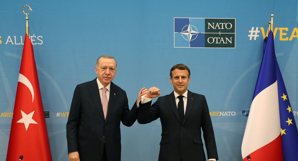 Turkish President Tayyip Erdogan meets with his French counterpart Emmanuel Macron during a bilateral meeting, on the sidelines of the NATO summit, in Brussels, Belgium June 14, 2021.