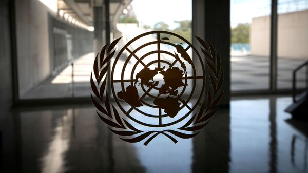 The United Nations logo is seen on a window in an empty hallway at United Nations headquarters during the 75th annual UN General Assembly high-level debate, which is being held mostly virtually due to the coronavirus disease (COVID-19) pandemic in New York, US, September 21, 2020 - Sputnik International