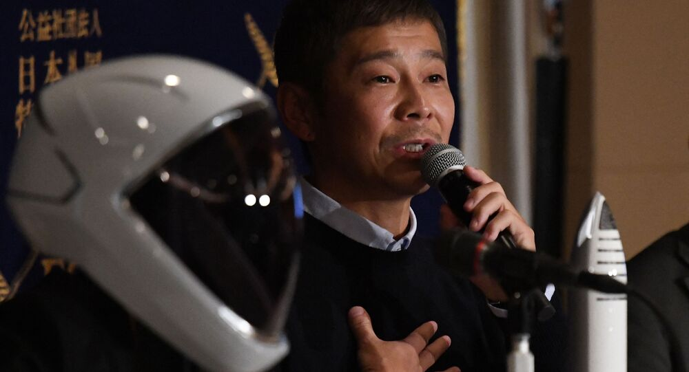 Yusaku Maezawa, entrepreneur and CEO of ZOZOTOWN and SpaceX BFR's first private passenger, speaks during a press conference at the Foreign Correspondents' Club of Japan in Tokyo on October 9, 2018