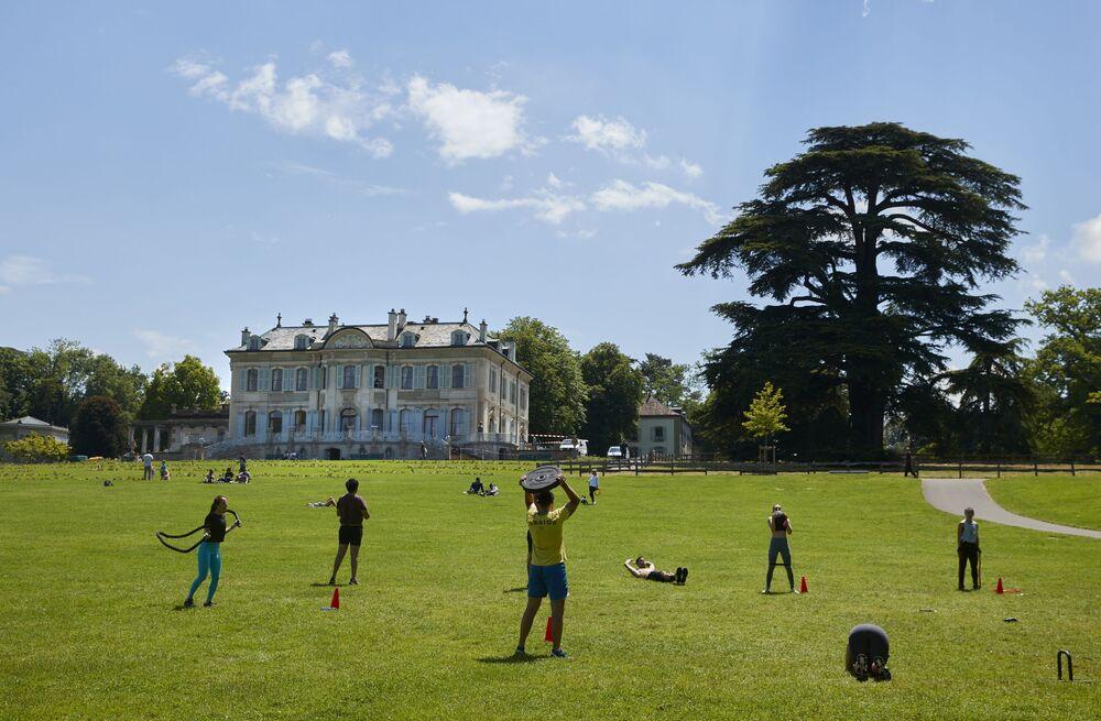 People exercise near Villa La Grange, ahead of the 16 June summit between US President Joe Biden and Russian President Vladimir Putin, in Geneva, Switzerland.