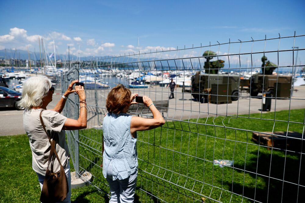People take photos of Swiss army radar station near Villa La Grange ahead of the 16 June summit between US President Joe Biden and Russian President Vladimir Putin.