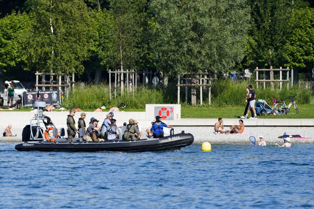 A boat with police officers patrols alongside the shore of the Lake Geneva near Villa La Grange in Geneva, Switzerland, Monday, 14 June 2021.