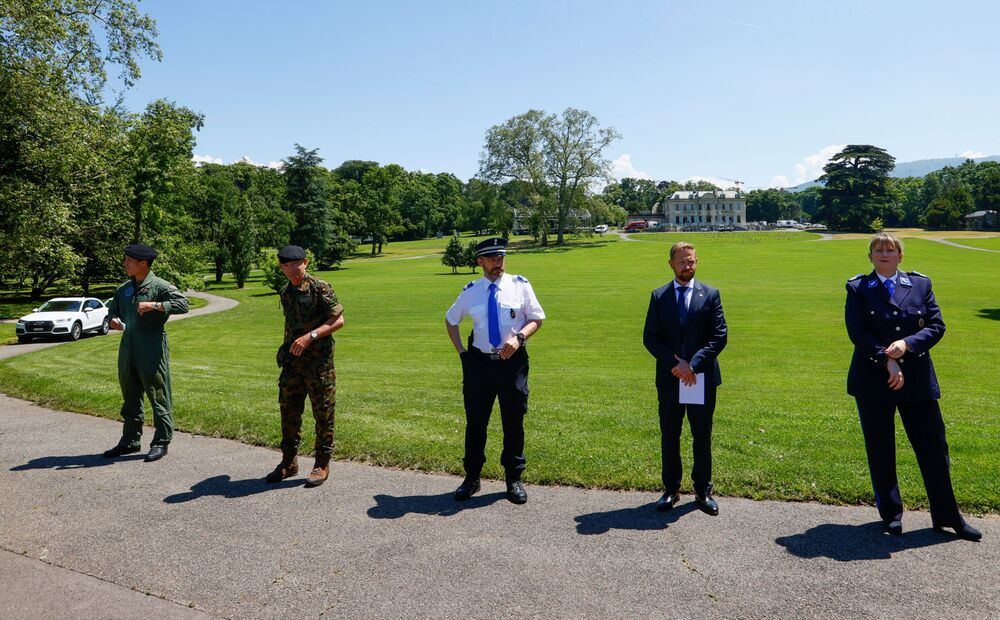 Swiss army's Pierre-Yves Eberle and Yvon Langel along with police officials, Francois Waridel, Stephane Theimer and Monica Bonfanti, hold a news conference outside Villa La Grange ahead of the 16 June summit between U.S. President Joe Biden and Russian President Vladimir Putin.