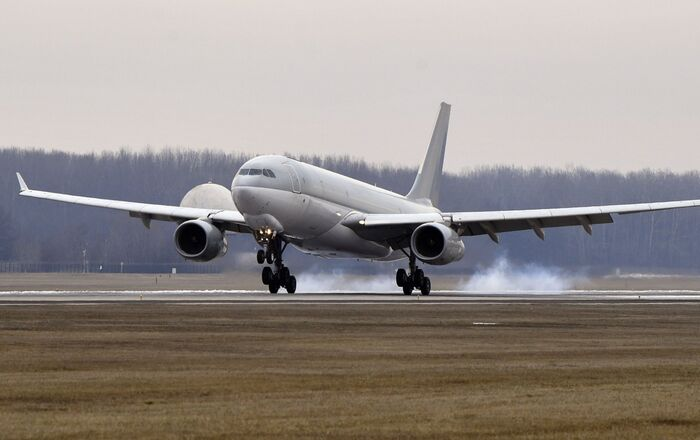 A Hungarian Airbus 330 plane transporting the first batch of the vaccine against the new coronavirus produced by Sinopharm of China to Hungary lands at Budapest Liszt Ferenc International Airport in Budapest, Hungary, Tuesday, Feb. 16, 2021