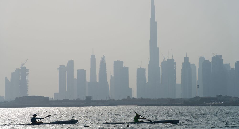 Kayakers race in front of the Burj Khalifa, the world's tallest building, off the coast of Dubai, United Arab Emirates on Friday, 19 June 2020.