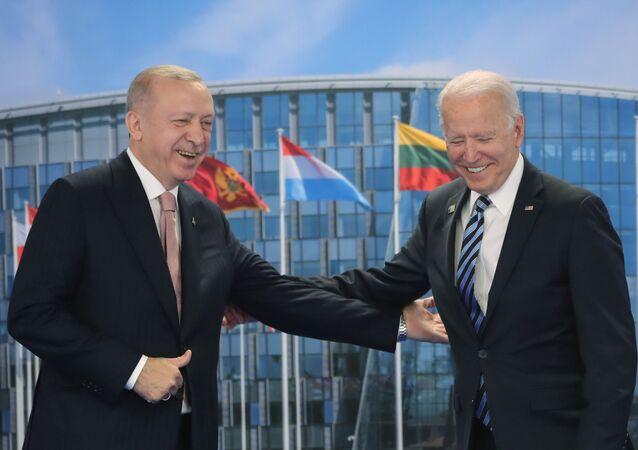 Turkish President Tayyip Erdogan meets with U.S. President Joe Biden on the sidelines of the NATO summit in Brussels, Belgium June 14, 2021.