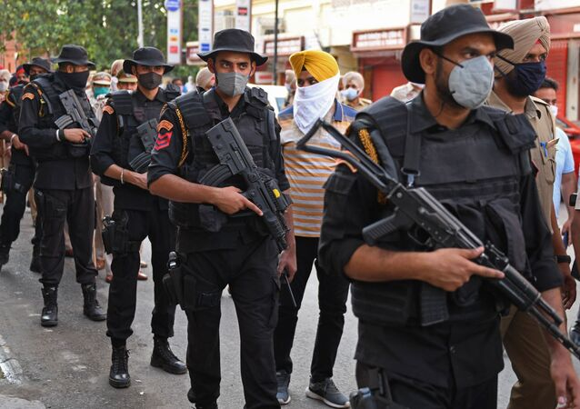 Police commandos patrol through a market area ahead of the 37th anniversary of Operation Blue Star in Amritsar on June 3, 2021.