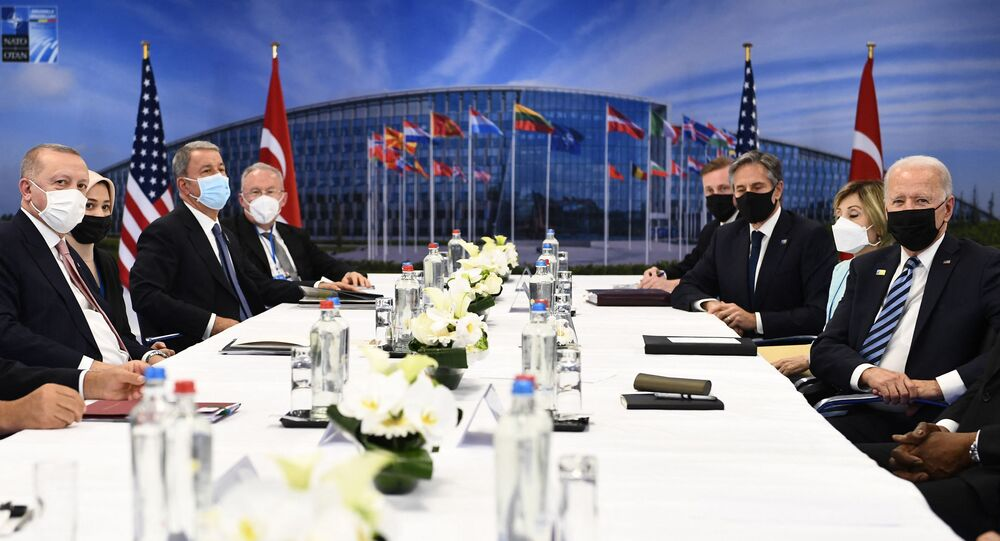 Turkey's President Recep Tayyip Erdogan (L) and US President Joe Biden (R) attend a bilateral meeting on the sidelines of the NATO summit at the North Atlantic Treaty Organization (NATO) headquarters in Brussels on June 14, 2021.