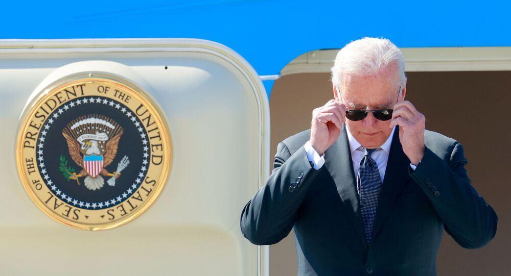 U.S. President Joe Biden steps off Air Force One at Cointrin airport as he arrives ahead of a meeting with Russian counterpart Vladimir Putin in Geneva, Switzerland, June 15, 2021