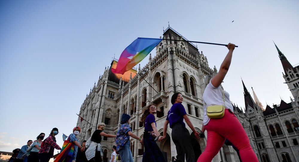 Demonstrators march as they protest against Hungarian Prime Minister Viktor Orban and the latest anti-LGBTQ law in Budapest, Hungary, June 14, 2021