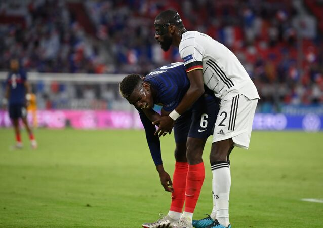 Soccer Football - Euro 2020 - Group F - France v Germany - Football Arena Munich, Munich, Germany - June 15, 2021 France's Paul Pogba and Germany's Antonio Rudiger