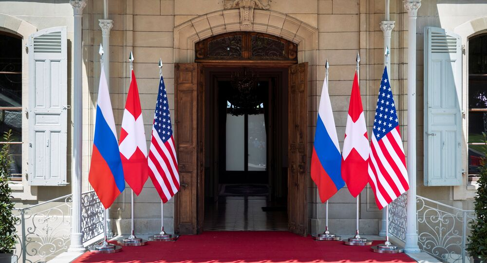 Flags of the U.S., Russia and Switzerland are pictured in front of the entrance of villa La Grange, one day prior to the meeting of U.S. President Joe Biden and Russian President Vladimir Putin in Geneva, Switzerland June 15, 2021