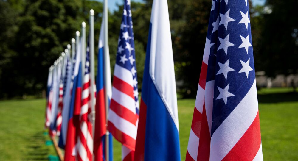 Flags of the U.S., Russia and Switzerland are pictured in the garden in front of villa La Grange, one day prior to the meeting of U.S. President Joe Biden and Russian President Vladimir Putin in Geneva, Switzerland