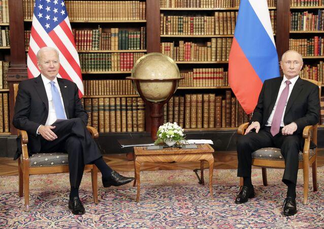 Russian President Vladimir Putin and U.S. President Joe Biden, left, attend a meeting at the Villa La Grange in Geneva, Switzerland
