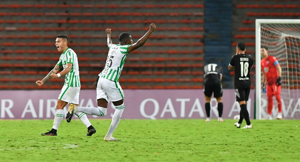 Yerson Mosquera (centre) celebrates as Colombia's Atletico Nacional defeat Libertad from Paraguay in April 2021