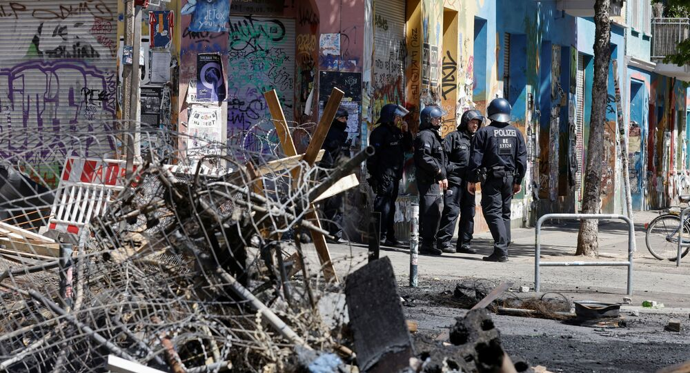 Police officers stand near extinguished barricades at Rigaer Street in Berlin, Germany, June 16, 2021