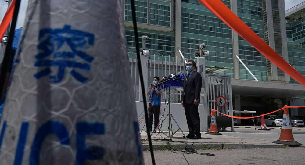 Hong Kong Police Force Senior Superintendent Steve Li Kwai-Wah speaks during a press conference outside the Apple Daily newspaper offices in Hong Kong on June 17, 2021