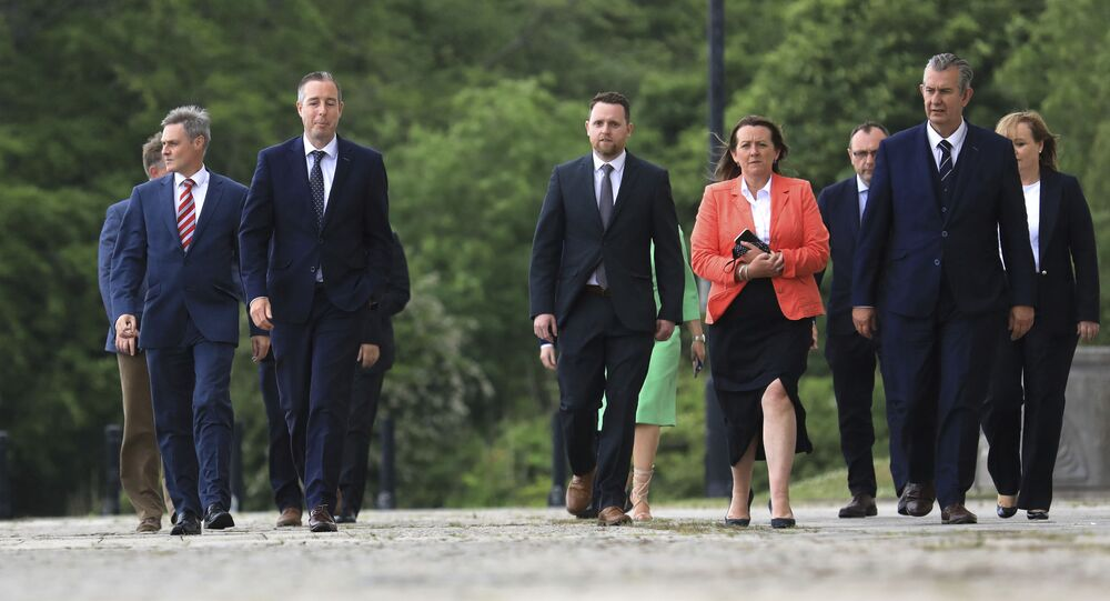 DUP leader Edwin Poots (far right) and the new First Minister Paul Givan (second from left) arrive at Stormont