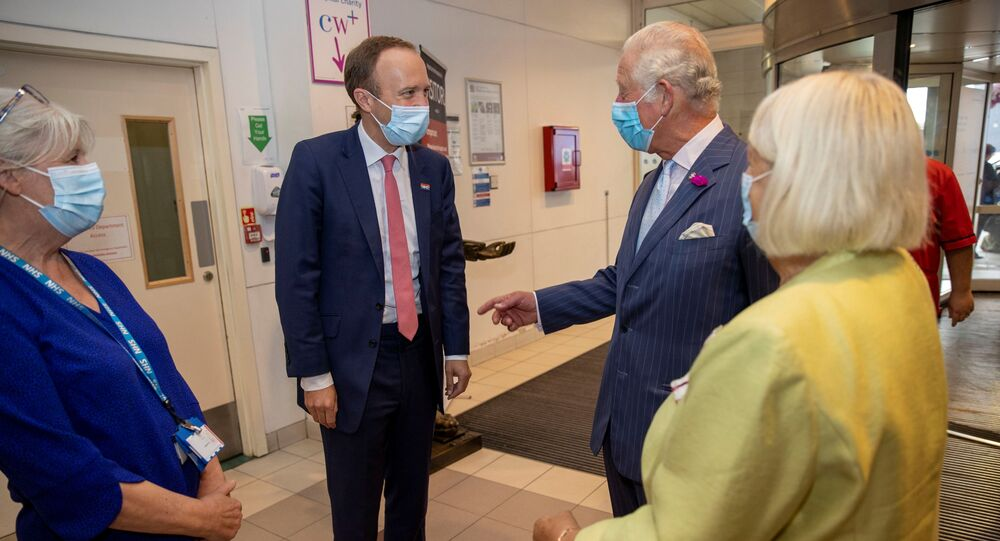 Britain's Prince Charles and Health Secretary Matt Hancock meet with NHS staff during a visit to Chelsea and Westminster hospital in London, Britain, 17 June 2021