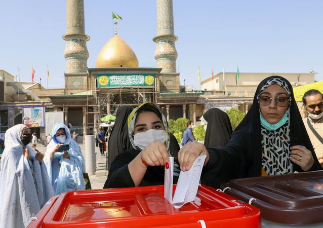 Iranian women cast their vote during presidential elections at a polling station in Tehran, Iran, 18 June 2021