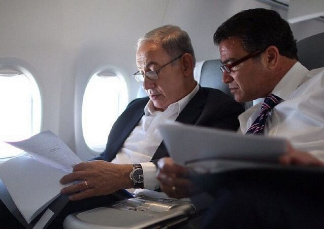 Benjamin Netanyahu and Yossi Cohen look over documents in a photo posted on social media by Netanyahu on December 7, 2015, shortly after he named Cohen as the new Mossad chief