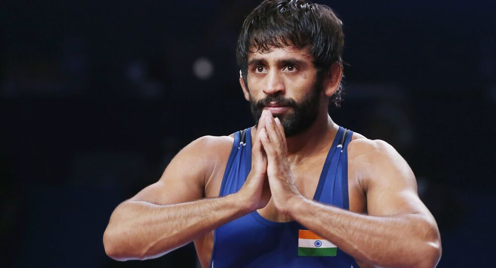 Bajrang Punia of India reacts as he won the bronze match of the men's 65kg category against Tulga Tumur Ochir of Mongolia during the Wrestling World Championships in Nur-Sultan, Kazakhstan, Friday, Sept. 20, 2019