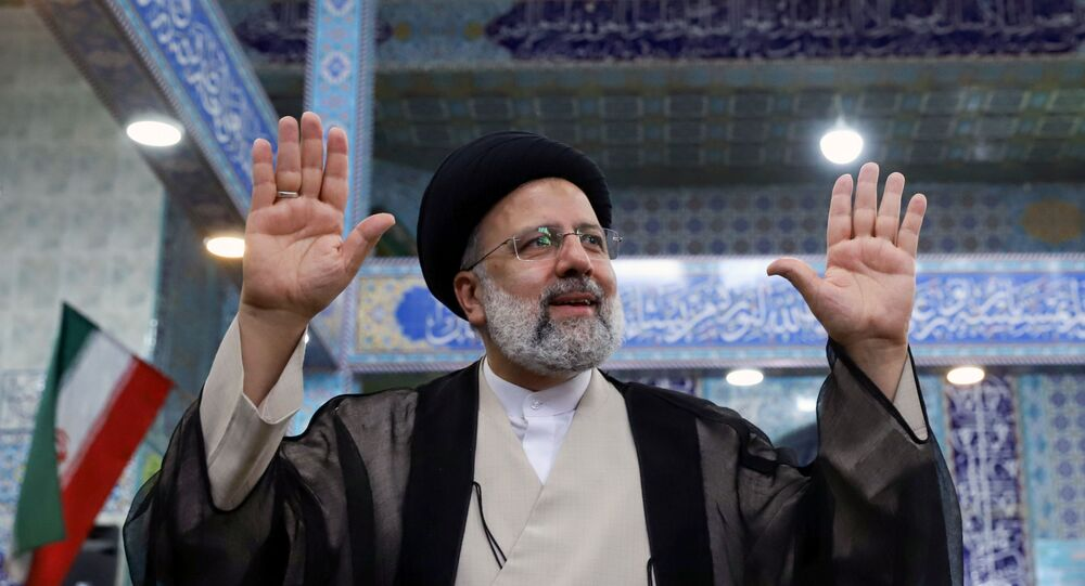 Presidential candidate Ebrahim Raisi gestures after casting his vote during presidential elections at a polling station in Tehran, Iran June 18, 2021. Majid Asgaripour/WANA (West Asia News Agency)