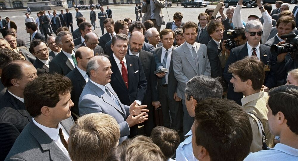 General Secretary of the CPSU Central Committee Mikhail Gorbachev and US President Ronald Reagan talk to journalists on Red Square during the visit of the American delegation to Moscow.