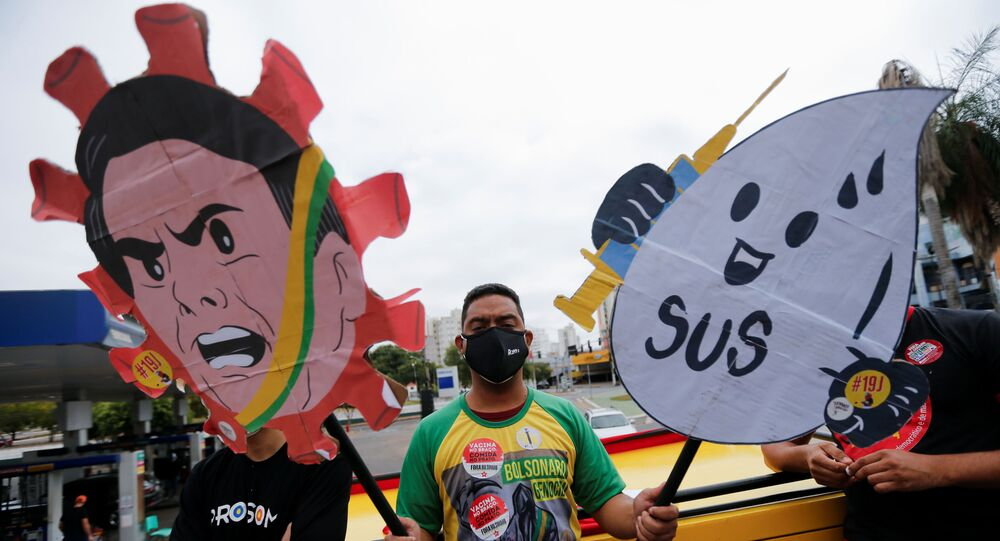 People participate in a protest against Brazil's President Jair Bolsonaro and his handling of the coronavirus disease (COVID-19) pandemic in Cuiaba, Brazil, June 19, 2021.