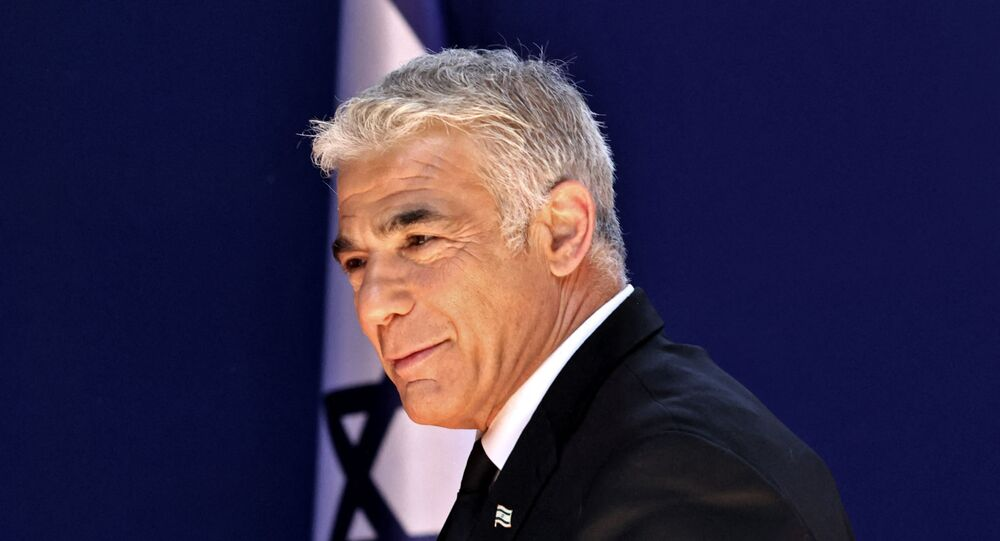 Israeli alternate Prime Minister and Foreign Minister Yair Lapid arrives for a photo at the President's residence during a ceremony for the new coalition government in Jerusalem, on June 14, 2021. - A motley alliance of Israeli parties on June 13 ended Benjamin Netanyahu's 12 straight years as prime minister, as parliament voted in a new government led by his former ally, right-wing Jewish nationalist Naftali Bennett.