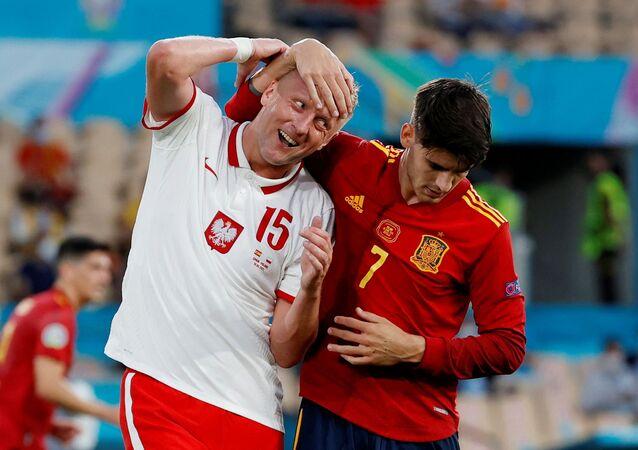 Soccer Football - Euro 2020 - Group E - Spain v Poland - La Cartuja Stadium, Seville, Spain - June 19, 2021 Poland's Kamil Glik in action with Spain's Alvaro Morata Pool via REUTERS/Julio Munoz