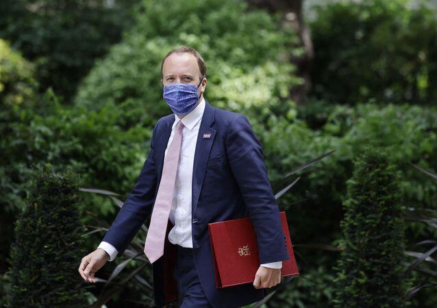 Britain's Health Secretary Matt Hancock walks along Downing Street in central London on June 15, 2021