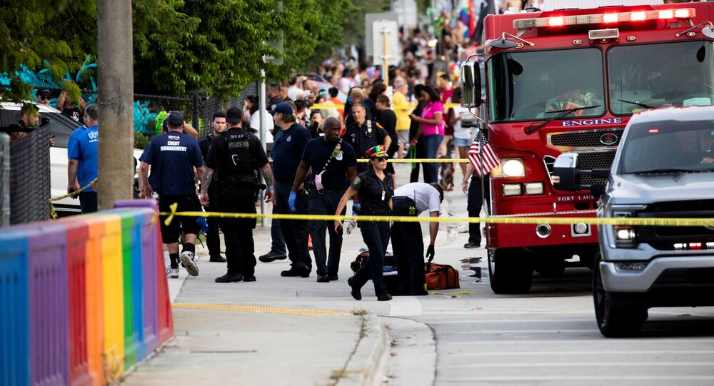 Police and firefighters respond after a truck drove into a crowd of people during The Stonewall Pride Parade and Street Festival in Wilton Manors, Florida, U.S. June 19, 2021