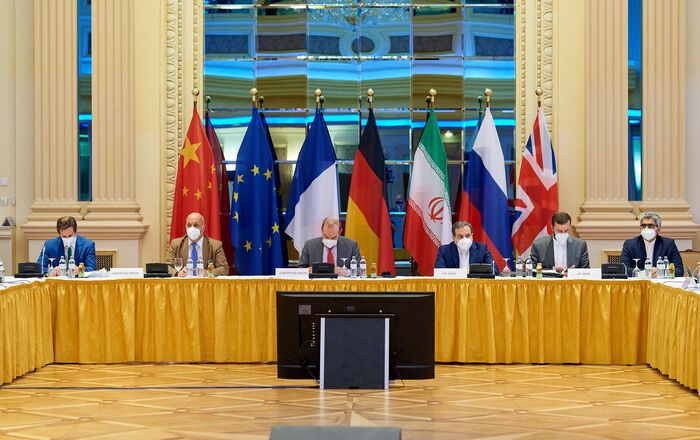 European External Action Service (EEAS) Deputy Secretary General Enrique Mora and Iranian Deputy at Ministry of Foreign Affairs Abbas Araghchi wait for the start of talks on reviving the 2015 Iran nuclear deal in Vienna, Austria June 20, 2021