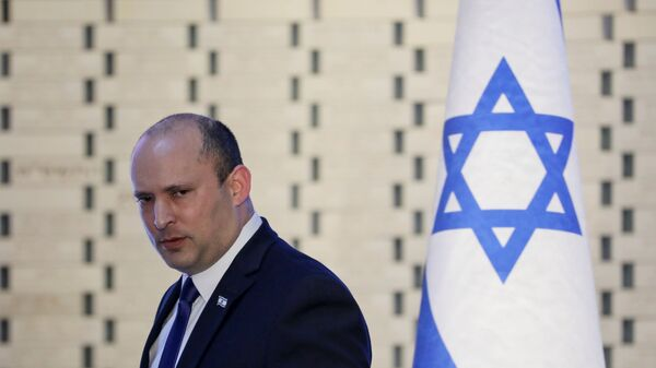 Israeli Prime Minister Naftali Bennett attends a memorial ceremony for soldiers who fell in the 2014 war with Gaza, at the Hall of Remembrance of Mount Herzl military cemetery in Jerusalem June 20, 2021 - Sputnik International