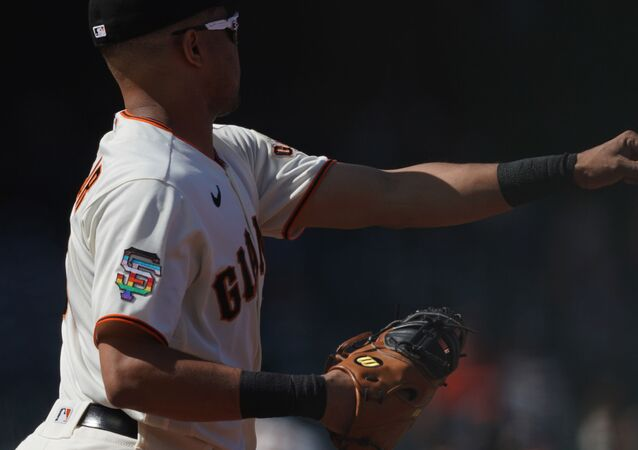 Jun 5, 2021; San Francisco, California, USA; San Francisco Giants first baseman LaMonte Wade Jr (31) warms up with a logo promoting LBGTQ+ pride on his uniform before the game against the Chicago Cubs at Oracle Park.