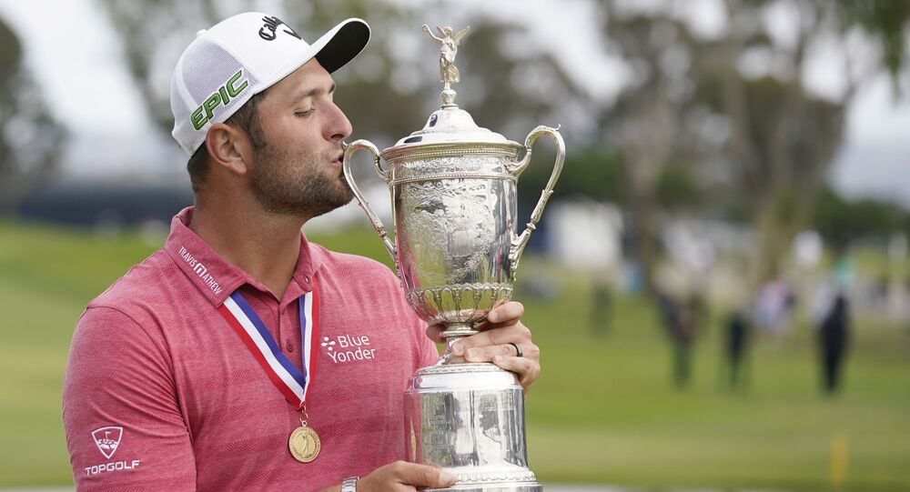 Jon Rahm celebrates and kisses the trophy after winning he U.S. Open golf tournament at Torrey Pines Golf Course, Jun 20, 2021