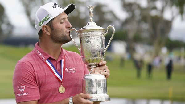 Jon Rahm celebrates and kisses the trophy after winning he U.S. Open golf tournament at Torrey Pines Golf Course, Jun 20, 2021 - Sputnik International